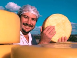 Man holding a wheel of cheese