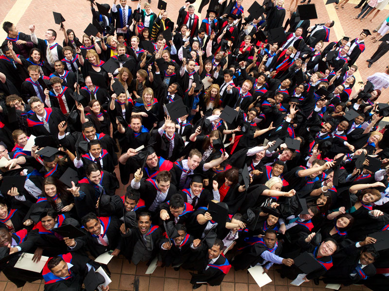 Graduates and CSU staff full of cheer at the end of the Faculty of Business ceremony on 17 December