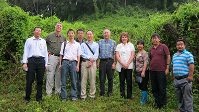 Professor Leslie Weston and Professor David Clements with Chinese collaborators in a lemon orchard that is engulfed with mile-a-minute