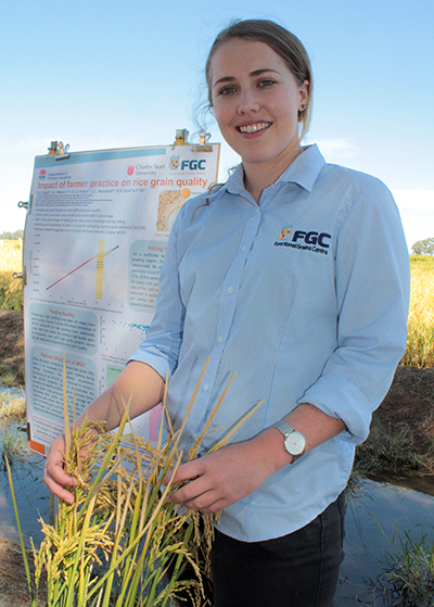 Ms Rachael Wood presents her research at the 2018 Rice Industry field day at Yanco, photo courtesy Bernadette York